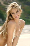 Portrait of beautiful blond girl with charming smile Stock Image