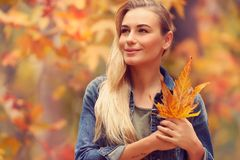 Beautiful girl enjoying autumn holidays Royalty Free Stock Image