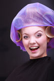 Portrait beautiful blond girl hair curlers rollers hairdresser beauty salon Stock Photography