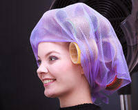 Portrait beautiful blond girl hair curlers rollers hairdresser beauty salon Royalty Free Stock Photos