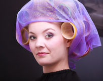 Portrait beautiful blond girl hair curlers rollers hairdresser beauty salon Stock Images
