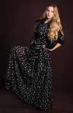 Portrait of the beautiful blond girl in long dress Stock Photos