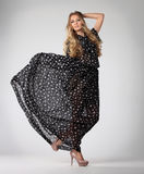 Portrait of the beautiful blond girl in long dress Royalty Free Stock Photos