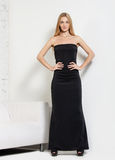 Portrait of the beautiful blond girl in long dress Stock Photography