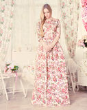 Portrait of the beautiful blond girl in long dress Royalty Free Stock Images
