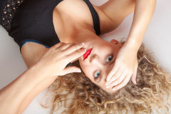 Portrait beautiful blond girl lying on floor Stock Image