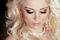 Portrait of beautiful blond girl with make up and curly hair. Je Stock Photos