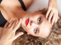 Portrait beautiful blond girl make up lying on floor studio shot Stock Photo