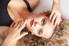 Portrait beautiful blond girl make up lying on floor studio shot Stock Images