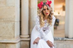Portrait of beautiful blond girl in medieval dress with red diadem. Fairy tale scene.  royalty free stock photography