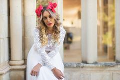 Portrait of beautiful blond girl in medieval dress with red diadem. Fairy tale scene.  stock image