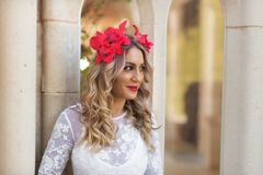 Portrait of beautiful blond girl in medieval dress with red diadem. Fairy tale scene.  stock photo