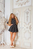 Portrait of the beautiful blond girl in polka dots dress Royalty Free Stock Images