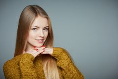 Portrait of beautiful blond girl in sweater royalty free stock images
