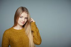Portrait of beautiful blond girl in sweater stock photos