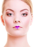 Portrait of beautiful blond girl woman with heart love symbol on lips. Valentines Day. Portrait of beautiful blond girl young woman with violet heart love symbol royalty free stock photos