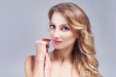 Portrait of beautiful blond hair woman. Clear skin, cosmetic. Portrait of beautiful blond hair woman. Perfect skin, cosmetic Royalty Free Stock Images