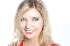 Portrait of a beautiful blond haired woman. With pale blue eyes smiling at camera Royalty Free Stock Photos