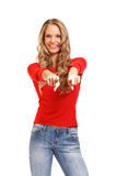 Portrait of a beautiful blond lady pointing at you stock images