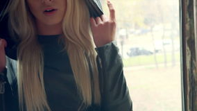 Portrait of the beautiful blond rapper girl stock footage