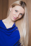 Portrait of beautiful blond smiling woman against wooden background Royalty Free Stock Photography