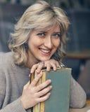 Portrait of beautiful blond woman. Blue eyed blond beauty smiling to camera Stock Photo