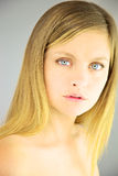 Portrait of beautiful blond woman with blue eyes without makeup Royalty Free Stock Images
