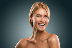 Portrait beautiful blond woman with blue eyes smiling, closeup Royalty Free Stock Images