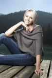 Portrait of a beautiful blond woman on a boardwalk Stock Photo
