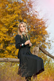 Portrait of beautiful blond woman with bouquet flowers Royalty Free Stock Images