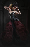 Portrait of beautiful blond woman in dark sexy corset Royalty Free Stock Photo