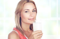 Beautiful woman drinking milk Stock Image