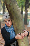 Portrait of beautiful blond woman in forest Royalty Free Stock Image