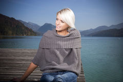Portrait of a beautiful blond woman by a lake Stock Photos