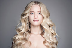 Portrait Of Beautiful Blond Woman With Long Wavy Hair. Portrait Of A Beautiful Young Blond Woman With Long Wavy Hair stock image