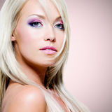 Portrait of the beautiful blond woman with pink makeup Stock Images