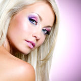 Portrait of the beautiful blond woman with pink makeup Stock Photo