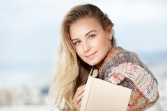 Pretty woman reads a book. Portrait of a beautiful blond woman with pleasure reading book at home, enjoying romantic story, happy carefree domestic life stock photo