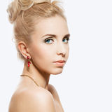 Portrait of beautiful blond woman with a ruby jewelry on.  Royalty Free Stock Photo
