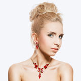 Portrait of beautiful blond woman with a ruby jewelry on. Royalty Free Stock Image
