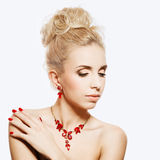 Portrait of beautiful blond woman with a ruby jewelry on. Stock Photo