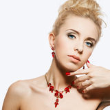 Portrait of beautiful blond woman with a ruby jewelry on. Stock Image