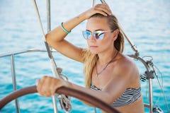 Beautiful woman on sailboat Stock Image
