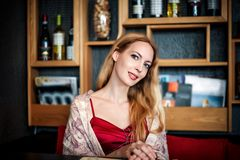 Portrait of beautiful blond woman sitting in cafe Stock Photo