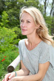 Portrait of beautiful blond woman standing outdoors. Portrait of beautiful blond woman Stock Photo