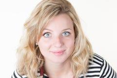 Portrait of a beautiful blond young blue eyes woman closeup shot Stock Image