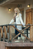 Portrait of Beautiful Blond Young Woman on Balcony Stock Photography