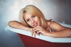 Portrait of a beautiful blonde in the bathroom Stock Images