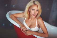 Portrait of a beautiful blonde in the bathroom Stock Image