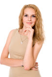 Portrait of a beautiful blonde in a beige jacket Stock Images